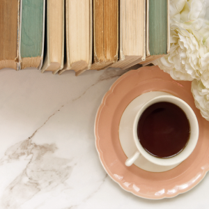 Top-down view of books and teacup